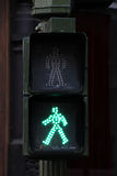Pedestrian crossing lights and traffic lights, green. Grey pedestrian crossing lights and traffic lights, green light, portrait cut Royalty Free Stock Photography