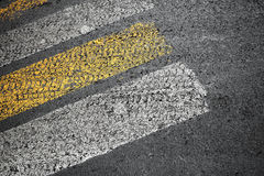 Pedestrian crossing marking on dirty road Royalty Free Stock Image