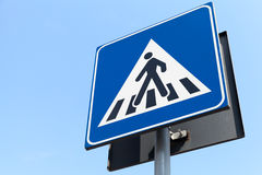 Pedestrian crossing. Modern two-sided road sign Royalty Free Stock Photography