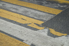 Pedestrian crossing. With the old road markings on a dark asphalt Royalty Free Stock Photography