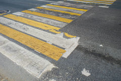 Pedestrian crossing. With the old road markings on a dark asphalt Royalty Free Stock Photo