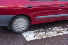 Pedestrian crossing. And a blurred car royalty free stock photos
