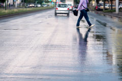 Pedestrian crossing rainy street Royalty Free Stock Images