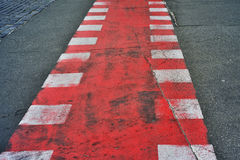 Pedestrian crossing with red and white marking Stock Photo