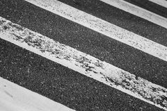 Pedestrian crossing road marking. On dark asphalt Royalty Free Stock Image