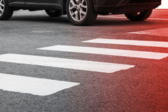 Pedestrian crossing road marking and moving car. Photo with red gradient tonal filter, selective focus and shallow DOF Stock Photography