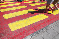 Pedestrian crossing road marking and people legs Stock Photos