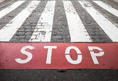 Pedestrian crossing road marking and red stop line Stock Photo