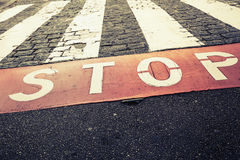 Pedestrian crossing road marking and red stop line Royalty Free Stock Photo