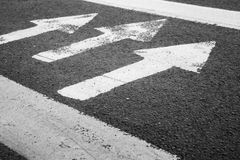 Pedestrian crossing road marking, white arrows Stock Photos