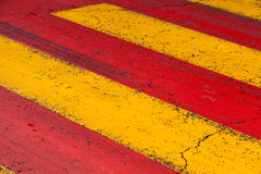 Pedestrian crossing road marking, yellow and red lines royalty free stock photos