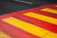 Pedestrian crossing road marking with yellow and red lines. On asphalt stock images