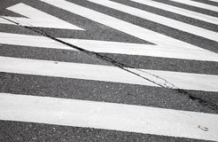 Pedestrian crossing road marking zebra, abstract. Dark gray asphalt road with pedestrian crossing road marking zebra, abstract transportation background Stock Photos