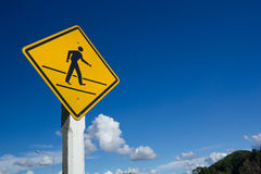 Pedestrian crossing road sign against blue sky. Royalty Free Stock Photos