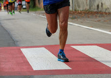 Pedestrian crossing with a runner who runs fast during the sport Royalty Free Stock Photo