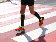 Pedestrian crossing with a runner who runs fast Stock Photography