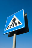 Pedestrian crossing sign. Pedestrian crossing road sign on blue sky Stock Photography