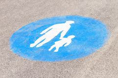Pedestrian crossing sign on asphalt. Blue caution for grandfather and child Stock Images
