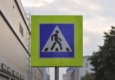 Pedestrian crossing sign. On a background of a city street Royalty Free Stock Photos