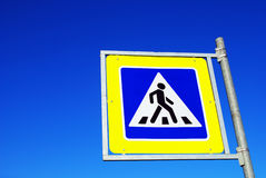 Pedestrian crossing sign. In blue sky Stock Photography