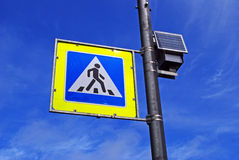 Pedestrian crossing sign. In blue sky Stock Photos