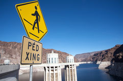 Pedestrian crossing sign at Hoover Dam. Yellow pedestrian crossing sign at Hoover Dam Royalty Free Stock Image
