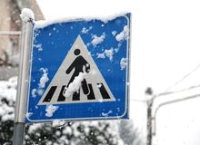 Pedestrian crossing sign in mountain village Royalty Free Stock Image