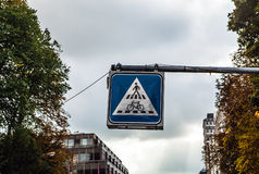 Pedestrian crossing sign over road Stock Photo
