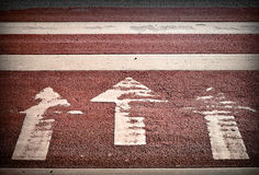 Pedestrian crossing with three arrows. And lines on asphalt Stock Photography