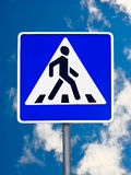 Pedestrian crossing traffic sign. On a sky background Stock Photo
