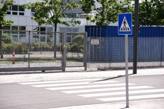 Pedestrian crossing. A pedestrian crossing with traffic signs before the entrance of a public and scientific establishment royalty free stock images