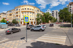 Pedestrian crossing with traffic signs and vehicles on the city. SAMARA, RUSSIA - JUNE 12, 2016: Pedestrian crossing with traffic signs and vehicles on the city Royalty Free Stock Photography