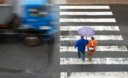 Pedestrian crossing with truck. In the rain stock images