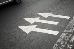 Pedestrian crossing with white arrows Royalty Free Stock Photography