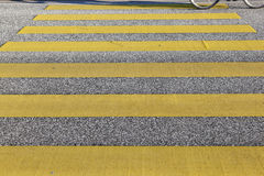 Pedestrian crossing with yellow stripes Royalty Free Stock Image