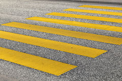 Pedestrian crossing with yellow stripes Stock Image