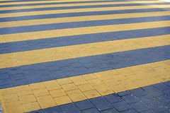 Pedestrian crossing with yellow stripes Royalty Free Stock Photos