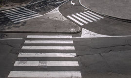 Pedestrian crossings. Traffic island with three pedestrian crossings photographed in low sunlight Stock Images