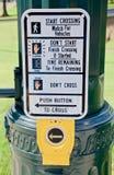 Pedestrian Crosswalk Instructions. A sign with instructions for pedestrians to cross and enter the crosswalk Stock Photo