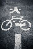 Pedestrian and cycle lane symbol on asphalt. Stock Photo