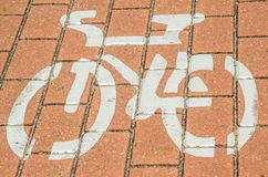Pedestrian and cycle path sign has painted on the red brick surface. royalty free stock photo
