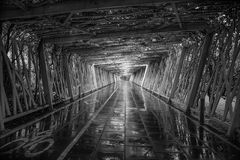 Pedestrian and cycling tunnel after rainfall in black and white royalty free stock photo