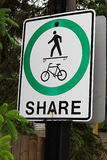 A pedestrian cyclist share path sign that has been vandalized to show a skateboarder instead Royalty Free Stock Images