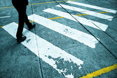 Pedestrian feet road crossing Stock Image
