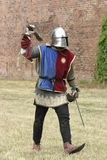 Pedestrian. Knight with weapon in hand Royalty Free Stock Image