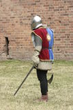 Pedestrian. Knight with weapon in hand Royalty Free Stock Images