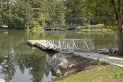 Pedestrian ladder and platform on a lake. Royalty Free Stock Image