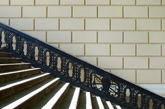Pedestrian ladder with a shod handrail. Pedestrian  ladder with a shod handrail at a wall Royalty Free Stock Photo