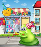 A pedestrian lane with a green monster near the party shop Stock Photo
