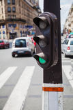 Pedestrian lights. With blurred traffic scene in Paris, France, in the background Stock Images